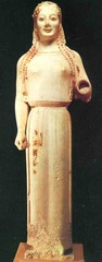 This sculpture is entitled___ it was dedicated in 530BCE and its medium is ___ ___